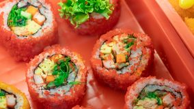 Eating Delicious California Sushi Roll royalty free stock photography