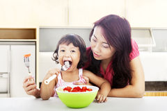 Eating delicious fruit salad Stock Photo