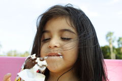 Eating Delicious Icecream. Cute little girl eating delicious icecream Royalty Free Stock Photo