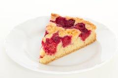 Eating delicious raspberry cake Stock Photo