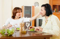 Eating a delicious salad of vegetables in the house. Man and women eating a delicious salad of vegetables in the house Royalty Free Stock Image