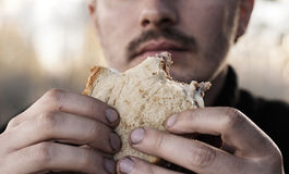Eating with dirty hands Stock Photo