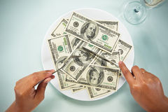 Eating the dollar bills Stock Photos
