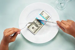 Eating the dollar bills Stock Photo