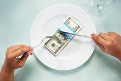 Eating the dollar bills Stock Photo