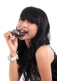 Eating donut Stock Images