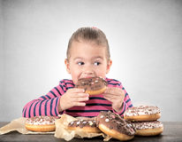 Eating donuts Royalty Free Stock Images