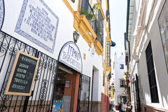 Eating and Drinking, narrow alleys in downtown Seville Stock Photos