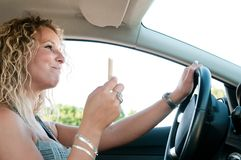 Eating while driving car Stock Photo