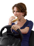 Eating While Driving Royalty Free Stock Photography