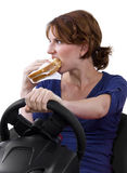 Eating While Driving Stock Photo