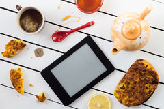 Eating and E-Reading. Egg and Cheese Sandwiches with Lemon and Honey Chamomile Tea Stock Images