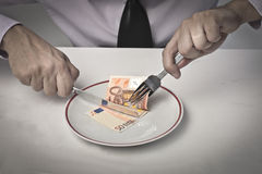 Eating Earnings Royalty Free Stock Photography