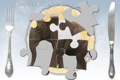 Eating an Elephant Royalty Free Stock Photography