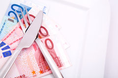 Eating Euros Stock Photo