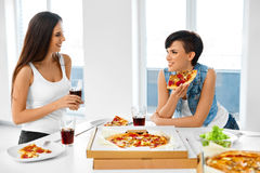 Eating Fast Food. Friends Eating Pizza. Home Party. Leisure, Cel Stock Photos