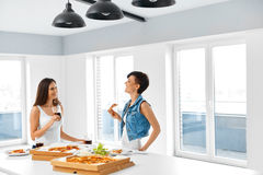 Eating Fast Food. Friends Eating Pizza. Home Party. Leisure, Cel Royalty Free Stock Photos