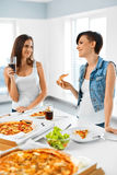 Eating Fast Food. Friends Eating Pizza. Home Party. Leisure, Cel Royalty Free Stock Images