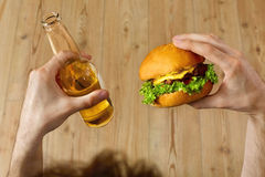 Eating Fast Food. Hamburger And Beer. Dinner At Restaurant. Nutr Royalty Free Stock Photo