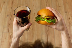 Eating Fast Food. Hamburger And Glass Of Soda. Dinner, Nutrition Royalty Free Stock Images