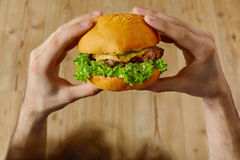 Eating Fast Food. Hands Holding Hamburger. Point Of View. Nutrit Stock Photos