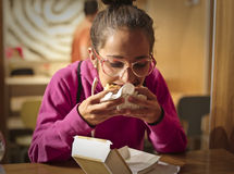 Eating in a fast food restaurant Stock Images