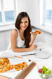 Eating Fast Food. Woman Eating Italian Pizza. Nutrition. Diet, L royalty free stock photography