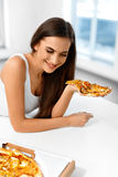 Eating Fast Food. Woman Eating Italian Pizza. Nutrition. Diet, L stock photos