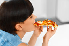 Eating Fast Food. Woman Eating Italian Pizza. Nutrition. Diet, L royalty free stock images