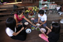 Eating on the Floor. Thai people eating their food on the floor in the traditional way. Bangkok, Thailand royalty free stock images
