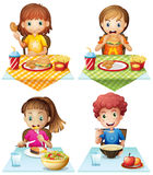 Eating food. Children eating food on the dining table stock illustration