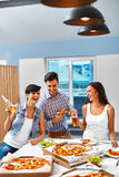 Eating Food. Friends Having Dinner Party. Holiday Celebration. F Royalty Free Stock Photography