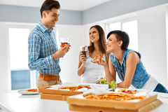 Eating Food. Friends Having Home Dinner Party. Friendship, Leisure Concept. stock image