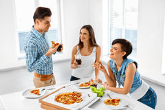 Eating Food. Friends Having Home Dinner Party. Friendship, Leisu Royalty Free Stock Photo
