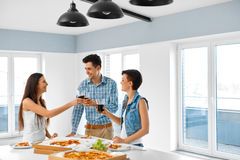 Eating Food. Friends Having Home Dinner Party. Friendship, Leisu Stock Photo