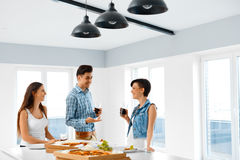Eating Food. Friends Having Home Dinner Party. Friendship, Leisu Royalty Free Stock Images