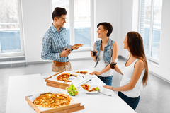 Eating Food. Friends Having Home Dinner Party. Friendship, Leisure Concept. royalty free stock images
