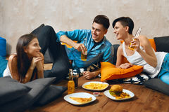 Eating Food. Group Of Friends Eating Fast Food, Drinking Soda. Eating Food. Group Of Happy Young Friends Eating Fast Food ( French Fries ) And Drinking Cold Soda Stock Photography