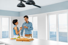 Eating Food. Happy Lovely Couple Eating Pizza Indoors. Leisure C Royalty Free Stock Photos