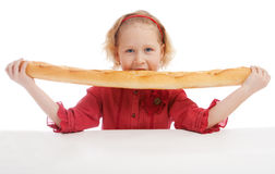 Eating French bread Stock Images