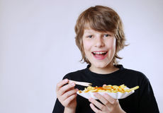 Eating french fries Stock Image