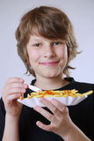 Eating french fries Stock Photo