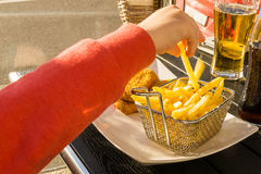 Eating french fries at a diner Stock Image