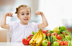 Eating fresh fruit. A beautiful girl eating fresh fruit Royalty Free Stock Photos