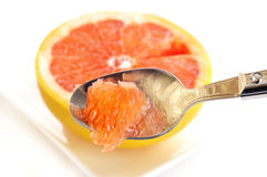 Eating fresh grapefruit Royalty Free Stock Image