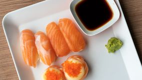 Eating Fresh Salmon Nigiri Sushi royalty free stock images