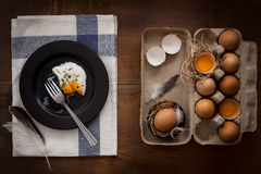 Eating fried eggs flat lay still life rustic with food stylish Royalty Free Stock Photos