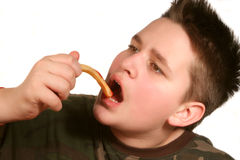 Eating fries royalty free stock photo