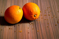 Eating fruit: oranges on brown table-set Royalty Free Stock Image
