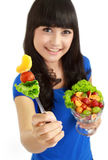 Eating fruit salad Stock Images